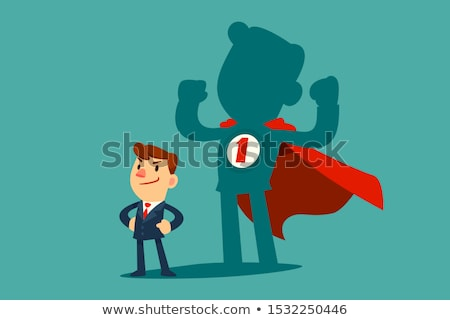 Businessman standing in front of a strong hero vision Stock photo © ra2studio