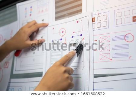 Háló designer dolgozik okostelefon felhasználó interfész Stock fotó © dolgachov