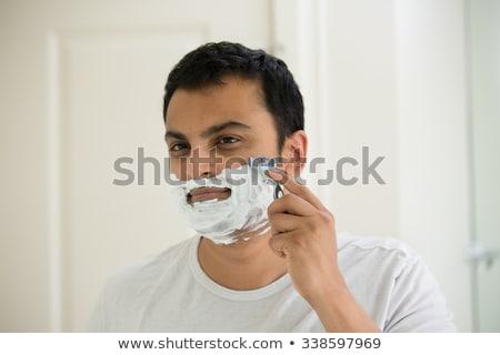 indian man shaving beard with razor blade Stock photo © dolgachov