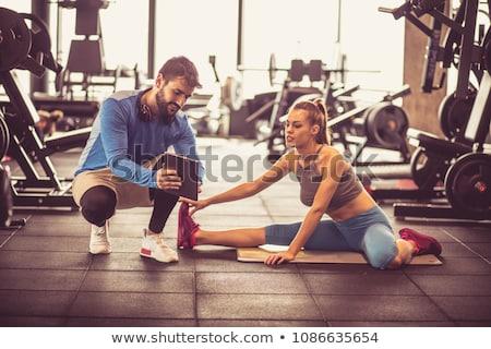 Ludzi szkolenia siłowni trener młodych Zdjęcia stock © Kzenon