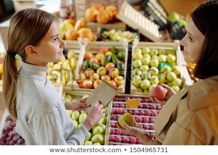 zakupy · listy · młoda · kobieta · supermarket - zdjęcia stock © pressmaster