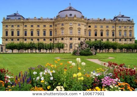 Wurzburg Residenz and colorful gardens view stock photo © xbrchx