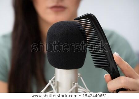 Vrouw kam microfoon meisje vrouwen Stockfoto © AndreyPopov