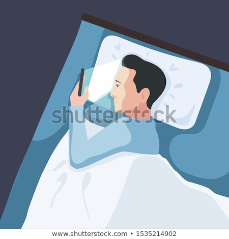 couple using smartphones in bed at night stock photo © dolgachov