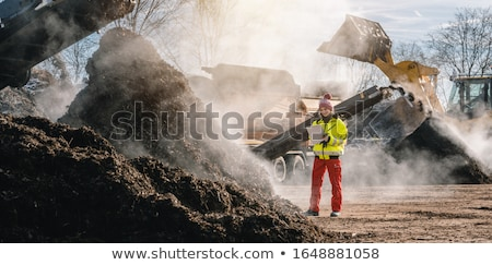 Woman worker with clipboard in industrial compost plant Stock photo © Kzenon