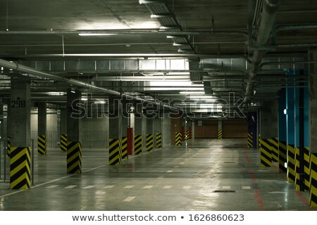 Perspective view of interior of empty parking area with rows of columns Stock photo © pressmaster