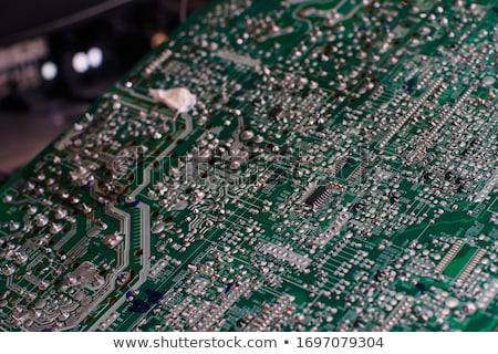 Technik inżynier koncentruje płytce drukowanej lutowanie Zdjęcia stock © Illia