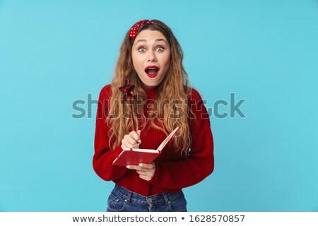 Afbeelding verwonderd blonde vrouw merkt dagboek Stockfoto © deandrobot