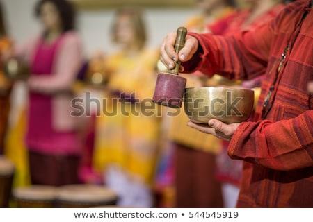 человека играет пения чаши мелкий Сток-фото © lightpoet
