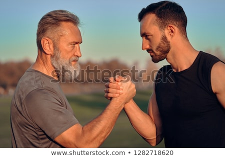 power struggle, father and son arm wrestling Stock photo © godfer