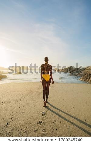 mujer · traje · de · baño · playa · puesta · de · sol · bikini - foto stock © stryjek
