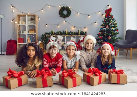 Portrait of a beautiful girl with a Christmas toy Stock photo © zastavkin