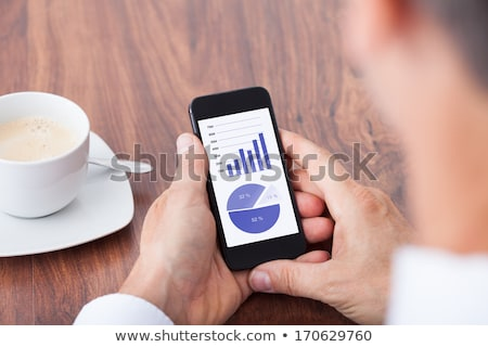 Stock photo: A close-up of a businessman and a pie chart.