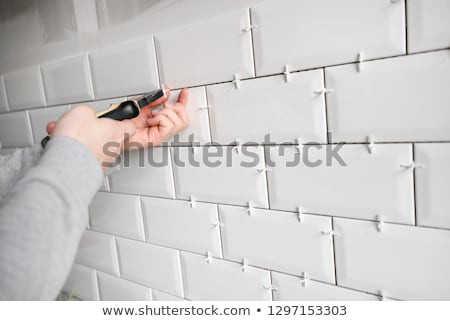 construction work detail of ceramic tile spacers Stock photo © lunamarina