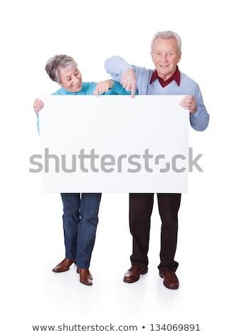 maturo · Coppia · bianco · cartellone · guardando - foto d'archivio © stockyimages