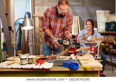 Young man using hacksaw Stock photo © photography33