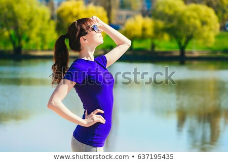 girl doing aerobics on the beach in the summer of glasses stock photo © OleksandrO