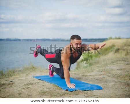 Beach Yoga with Young Couple - Vertical stock photo © Schmedia