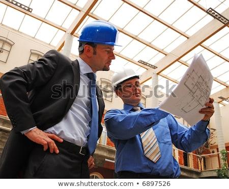 Tradesman studying a blueprint Stock photo © photography33
