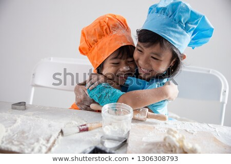 Two people hugging each other in a kitchen  Stock photo © wavebreak_media