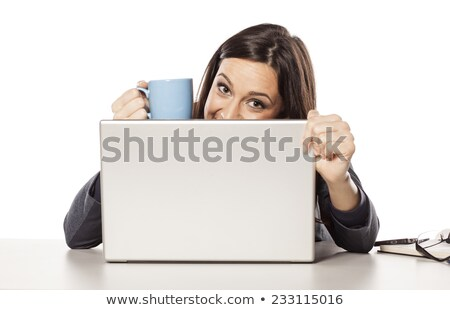 Woman peeking out from behind a laptop Stock photo © photography33