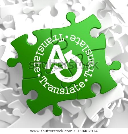 Translating Concept  on Green Puzzle Pieces. Stock photo © tashatuvango