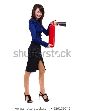 beautiful young businesswoman using a fire extinguisher isolated on white stock photo © pxhidalgo