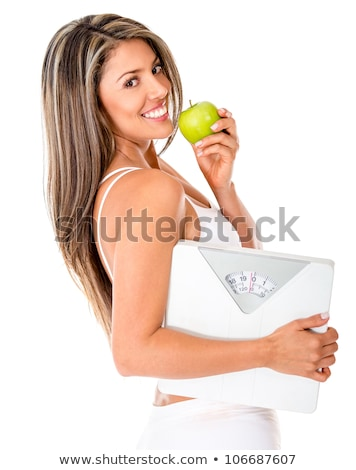 loosing weight - woman with scale and apple Stock photo © Kzenon