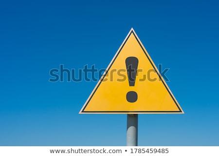 黄色 · 遅く · ダウン · 青空 · 道路標識 - ストックフォト © iqoncept