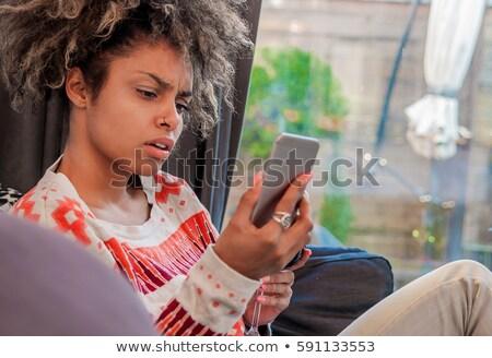 Annoyed on the phone Stock photo © runzelkorn
