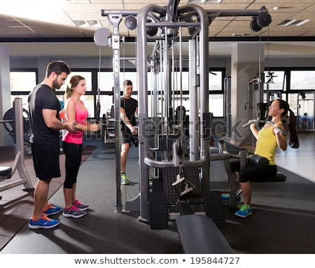 Kabel personal trainer man vrouw leren fitness Stockfoto © lunamarina