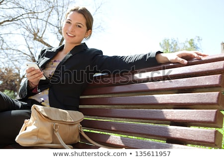 successful businesswomen in the city on a bench stock photo © geribody