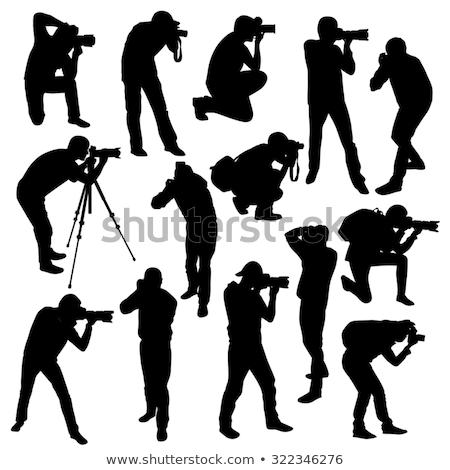 Fotógrafo silhuetas homem tecnologia vídeo lente Foto stock © Slobelix