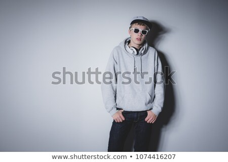 man leaning on wall holding his hand on his neck Stock photo © feedough