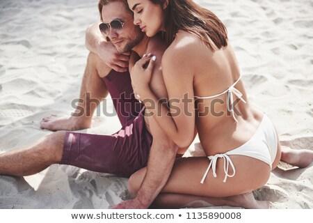Couple in bathing clothes Stock photo © phakimata