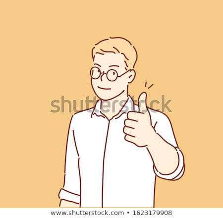 confident mature businessman gesturing thumbs up stock photo © andreypopov