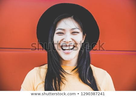 Cheerful girl posing in casuals Stock photo © stockyimages