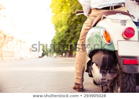 Closeup portrait of a scooter with male legs Stock photo © deandrobot