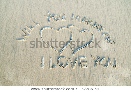 Heart drawn on sand with marry me text Stock photo © netkov1