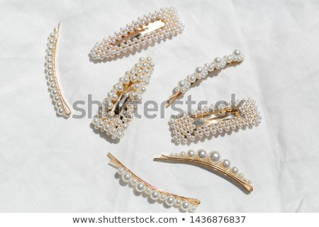 Gold barrette Stock photo © GeniusKp