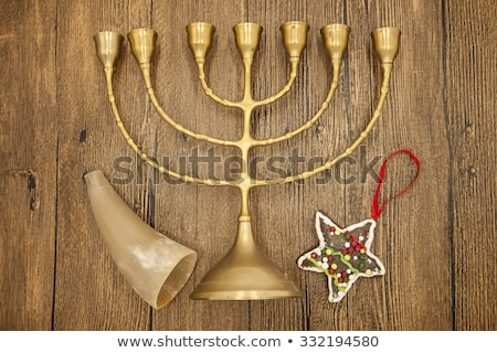 hanukkah is the jewish new year candle with christmas ornaments and cookies horn on wooden backgrou stock photo © mcherevan