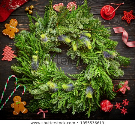 christmas wreath with bells on dark wooden background stock photo © gigra