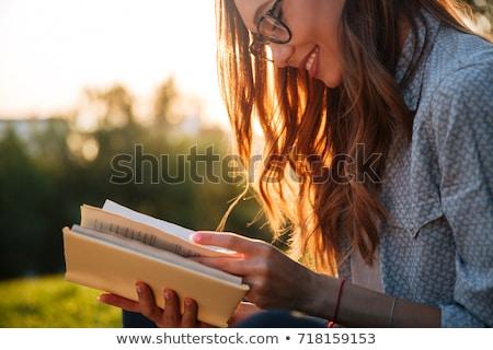 счастливым чтение книга красивой сидят Сток-фото © filipw