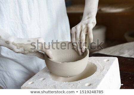 Making a porcelain vase with clay Stock photo © bbbar
