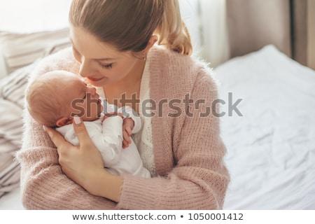 Pasgeboren baby glimlach kind oranje bed Stockfoto © zurijeta
