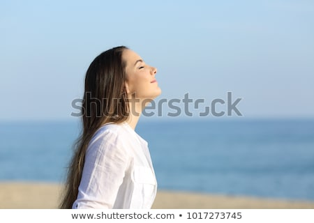 Young happy relaxed girl in nature  breathing fresh air Stock photo © zurijeta