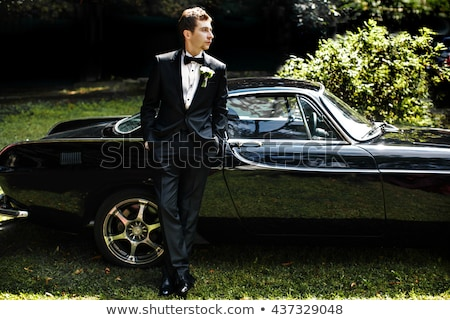 Poważny pan młody samochodu młodych przystojny mężczyzna apartament Zdjęcia stock © artfotodima