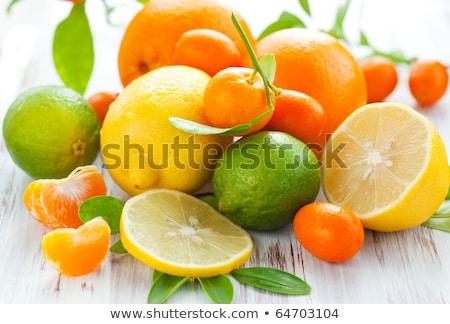 Csendélet érett lédús citrus gyümölcsök fa asztal Stock fotó © dariazu