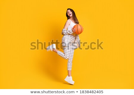 Attractive young woman in sports wear holding basket ball Stock photo © deandrobot