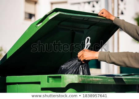 Dirty trashcan and bags Stock photo © bluering